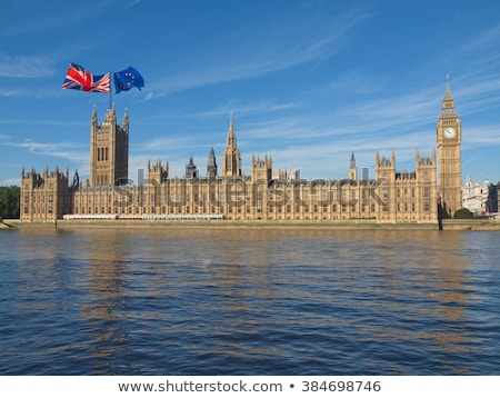 Two houses with flags of United Kingdom and EU Stock photo © MikhailMishchenko