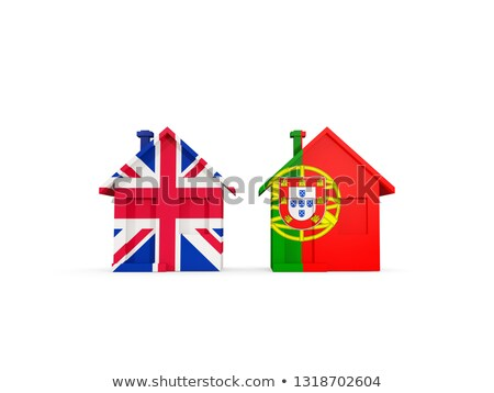 Two houses with flags of United Kingdom and portugal Stock photo © MikhailMishchenko