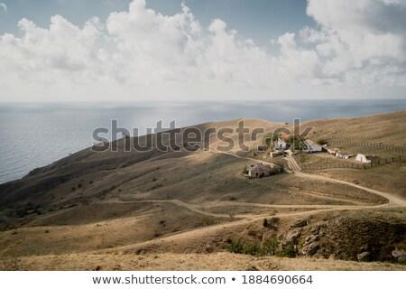 Trópusi tenger kövek kék dombok távolság Stock fotó © galitskaya