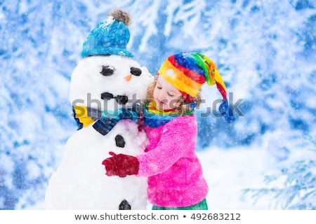 children building snowman kids having fun winter stock photo © robuart