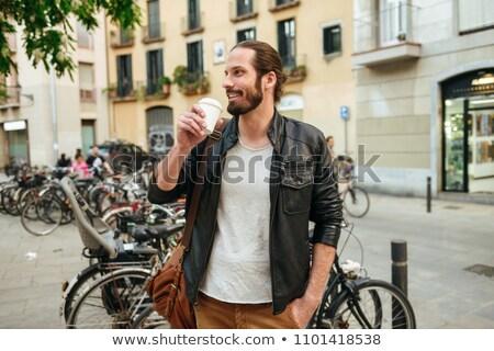 Portre yakışıklı adam 30s deri ceket içme Stok fotoğraf © deandrobot