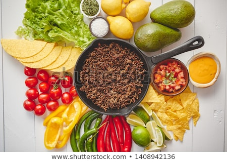 Ingredients for Chili con carne in frying iron pan on white wooden table Stock photo © dash