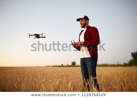 Man holds remote controller with his hands and controls the drone. New technologies and innovations  Stock photo © galitskaya