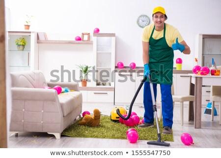 Genç erkek ev işi parti çalışmak Stok fotoğraf © Elnur