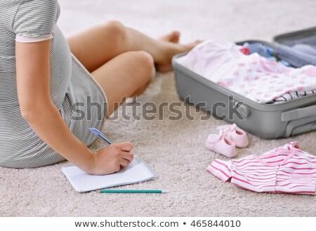 Terhes nő csomagol táska kismama kórház terhesség Stock fotó © dolgachov