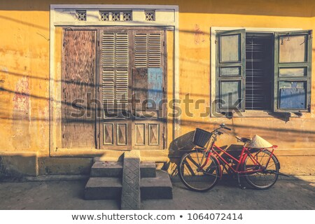 Stock photo: Bicycle parked near wall on street