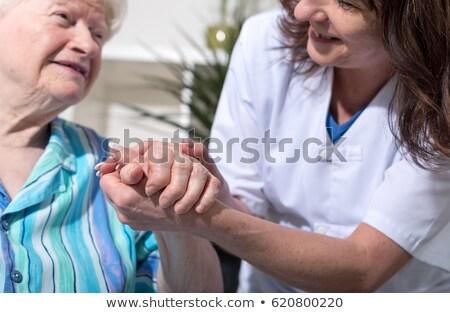 Supérieurs femme pension maison main Photo stock © Kzenon