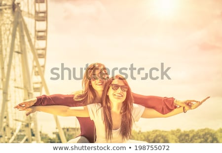 Two best friends embracing outdoors. Women friendship concept Stock photo © GVS