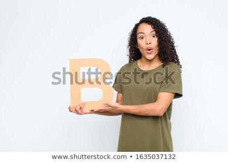 Woman holding typewriter. Stock photo © iofoto
