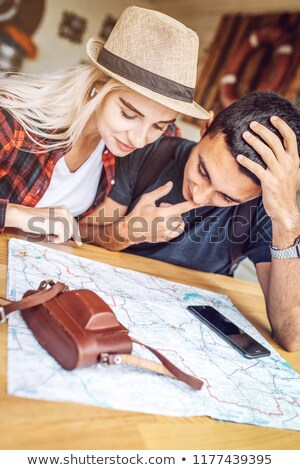 Couple looking at an orientation table Stock photo © photography33