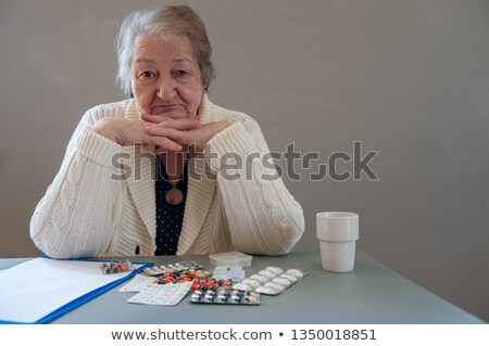 Older woman concerned about her pills Stock photo © photography33
