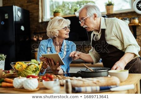 Woman following a recipe Stock photo © photography33