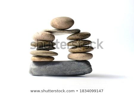 Dengeli zen taşlar yalıtılmış beyaz Stok fotoğraf © calvste