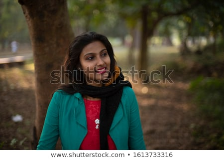 Stock photo: asian indian woman portrait in golden autumn field