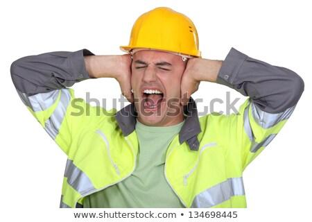 Człowiek kask hałasu budowy niebieski pracownika Zdjęcia stock © photography33