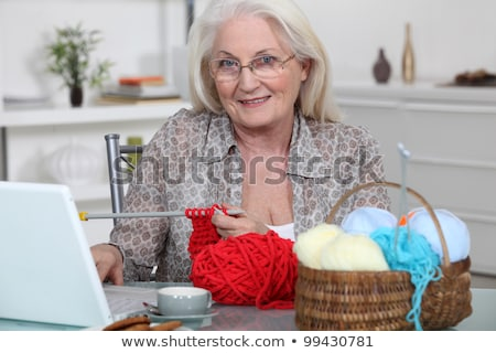 senior woman knitting in front of her laptop computer stock photo © photography33