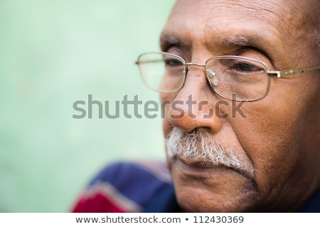 Face in bad old glasses close-up stock photo © pzaxe