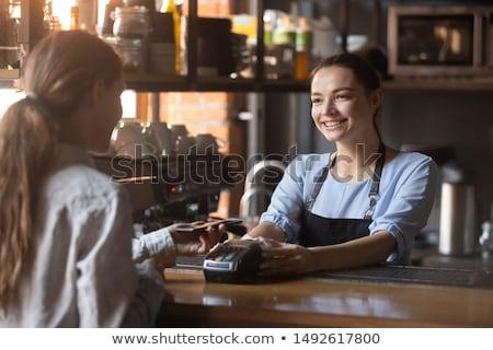 Waitress handing a phone. Stock photo © photography33