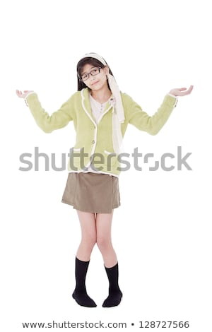Girl in green sweater and glasses gesturing 'I do not know'. stock photo © jarenwicklund