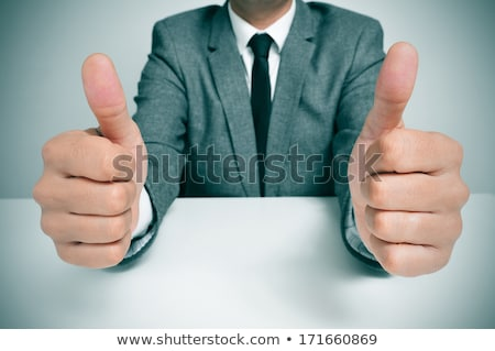 Man giving okay sign Stock photo © elenaphoto