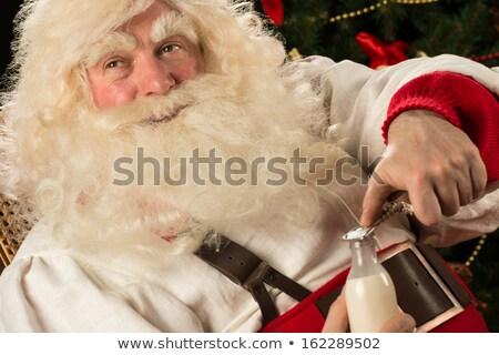 Santa Claus holding bottle of milk Stock photo © HASLOO