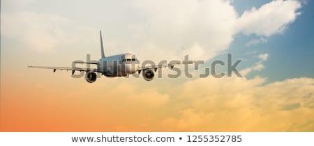 Vleugel vliegtuig vliegen boven wolken mensen Stockfoto © rufous