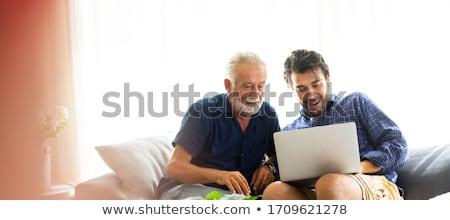 Adulto figlia senior padre utilizzando il computer portatile home Foto d'archivio © monkey_business