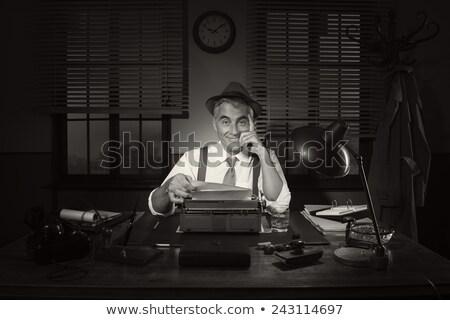 smiling man with vintage typewriter Stock photo © tiero