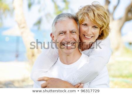 Középső kor pár zárt szemtől szembe portré Stock fotó © stryjek