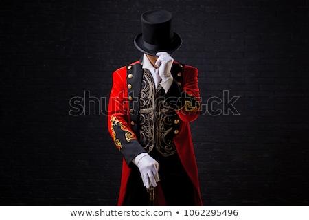 Showman on black background Stock photo © HASLOO
