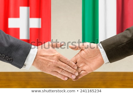 representatives of switzerland and italy shake hands stock photo © zerbor