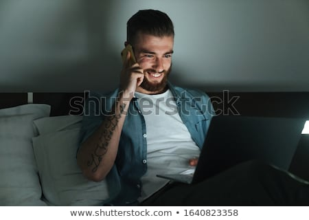男 · スマートフォン · ベッド · 魅力的な · 若い男 · 白 - ストックフォト © nito