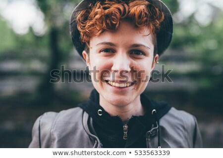 vrouw · naar · camera · buitenshuis · portret - stockfoto © deandrobot
