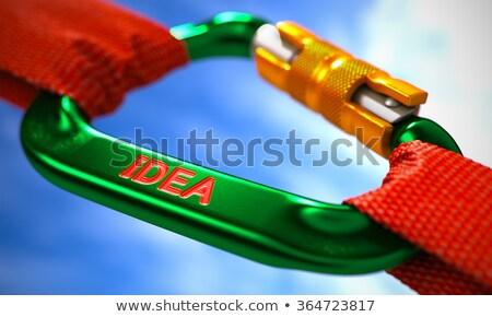 Idea on Green Carabiner between Red Ropes. Stock photo © tashatuvango