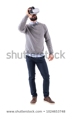 Adult male with virtual reality glasses looks up Stock photo © ozgur