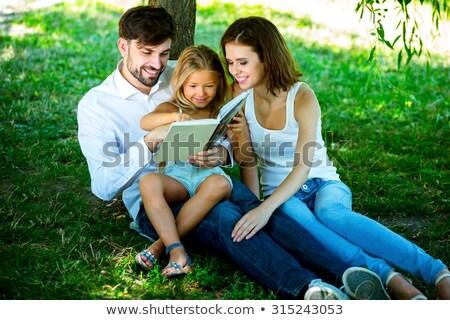 матери · чтение · книга · счастливая · семья · детей · сидят - Сток-фото © meinzahn
