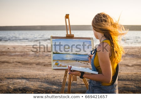 young woman with an easel  Stock photo © OleksandrO