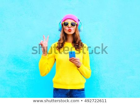 Dość młoda kobieta słuchawki niebieski odizolowany Zdjęcia stock © deandrobot