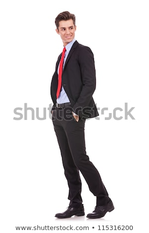 side view of a young business man standing in studio stock photo © feedough