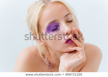 Tender cute girl with bright creative makeup and eyes closed Stock photo © deandrobot