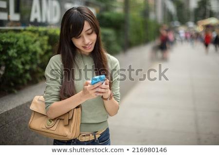 Kozmopolit kız genç kadın yürüyüş merdiven modern bina Stok fotoğraf © iko