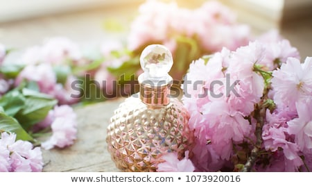 Arabian woman with bottle of perfume isolated on white Stock photo © Elnur