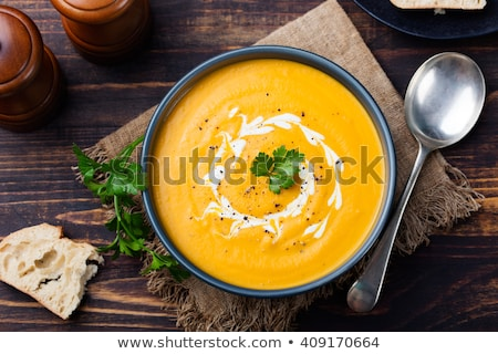 Stock photo: Pumpkin and carrot soup with cream and parsley