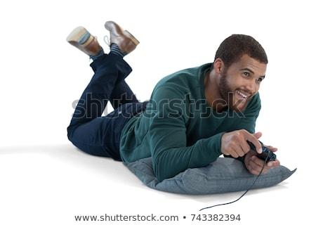 улыбаясь · человека · играет · видеоигра · белый · портрет - Сток-фото © wavebreak_media