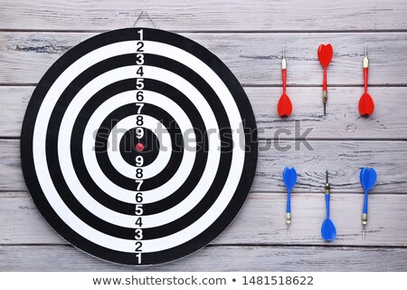 Red Arrow In Dartboard On Table Stock photo © AndreyPopov