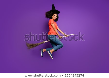 Full length image of happy woman in halloween costume Stock photo © deandrobot