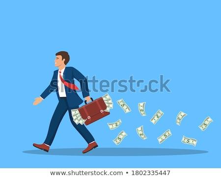 caucasian businessman with briefcase full of money stock photo © rastudio