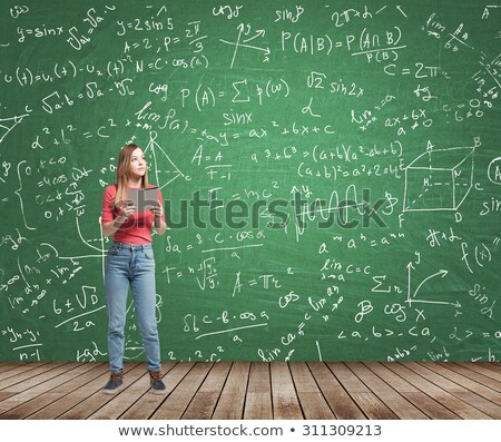 Hand Drawn Learn Economics on Green Chalkboard. Stock photo © tashatuvango