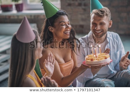Young woman with man blowing party balloons Stock photo © Giulio_Fornasar