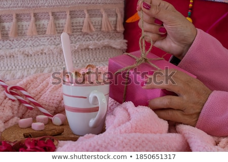 close up of woman with sweets and cocoa in bed Stock photo © dolgachov